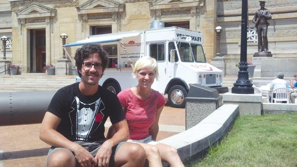 Tim Tobitsch and Megan Lindsey, owners of the Franktuary Truck, a pioneer in the local food-truck industry. - PHOTO BY AMYJO BROWN
