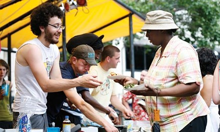 Tom Furari, a 3-year Food Not Bombs volunteer from Bloomfield, serves lunch in Market Square. - HEATHER MULL