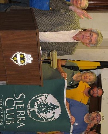 Tom Hoffman (at podium) and other activists hail passage of council's new diesel-emissions bill. - PHOTOS BY CHRIS YOUNG
