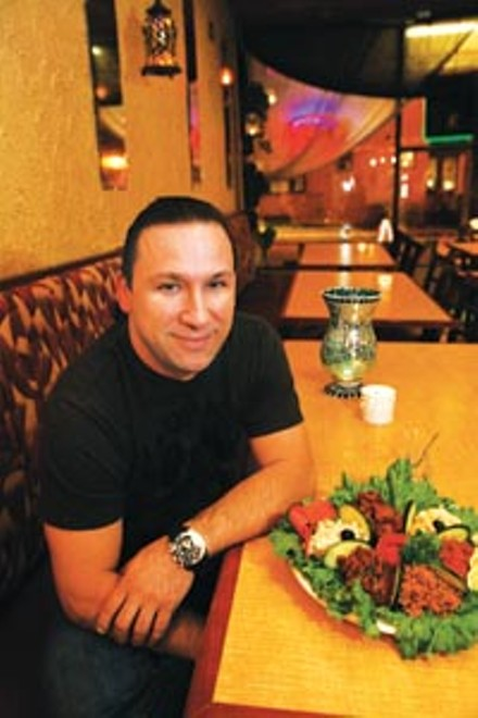 "Turkish delight: Owner Coskun ""Josh"" Gokalp, in Istanbul Grille's new Shadyside location. - HEATHER MULL"