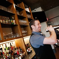 Bartender Jimmy Wise mixes a cocktail behind the bar at Siempre Algo.