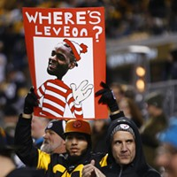 A fan holds up a sign asking, 'Where's Le'Veon?'