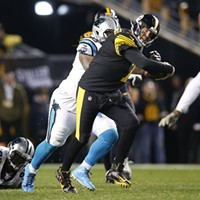 Roethlisberger uses his feet to pick up a first down.