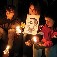 Fans mourn Mac Miller at a memorial vigil after the artist's death in September.