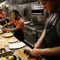 Sous chef Jeff Green (middle) prepares house-made Bistec A La Plancha at Morcilla