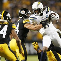 Mike Williams of the Chargers is tackled by L.J. Fort following a catch.
