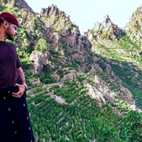 Mokhtar overlooking coffee terraces in the region of Bura