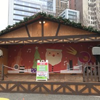 Holiday Market stage is now without Colcom Foundation sign