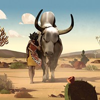 Liyana traverses the desert with her bull.