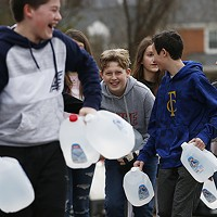 Shadyside Academy eighth grader Parker Mendham, 13, helps his classmates load up water into a car during a 412 Food Rescue