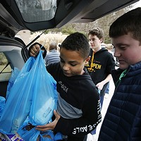 Shadyside Academy eighth grader Maxwell Kimbrough, 13, haps load up food supplies into a car during a 412 Food Rescue