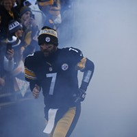 Ben Roethlisberger enters the field amidst the smoke.