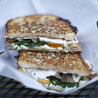 Pressed sandwich with burrata, roasted mushroom, tomato, and arugula