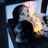 Part of Vivo's outdoor patio includes a gas fire pit with a trio of skulls