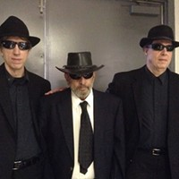 Men in black pictured with Fred Saluga, director of Fayette County Pa. Bigfoot Research Project, at the 10th Annual Butler Paranormal Conference
