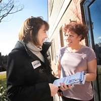 Pam Iovino (left) talking with a voter before Election Day