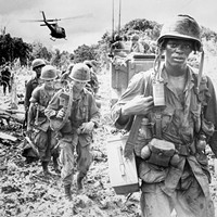 Men of the 173rd Airborne Brigade on a search and destroy patrol after receiving supplies, 1966.