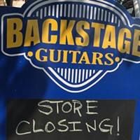 Sign in front of Backstage Guitars