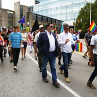 Mayor Bill Peduto walks with the People's Pride march.