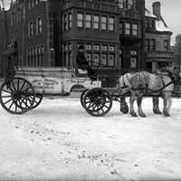 Archival photo of the Allegheny Stables property and DPW carriage