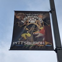 An Anthrocon flag welcomes furries to Pittsburgh on Liberty Avenue in Downtown Pittsburgh.