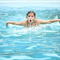 Elyse, 12, practices her fly swim at the Bloomfield pool