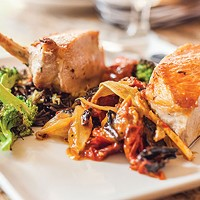 Grilled pork chop, with heirloom tomato, fennel, garlic scapes, broccoli and wild rice