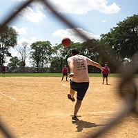 A player winds up at the Steel City kickball playoffs.