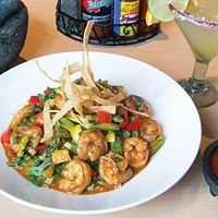 Grilled shrimp, bell peppers, peas, onions and asparagus sautéed in a spicy chipotle sauce. Served over cilantro rice and topped with tortilla strips.