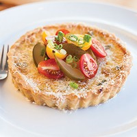 Aubergine Bistro's ricotta tart, with corn, green beans, caramelized onions, tomato salad dill pickles and scallions