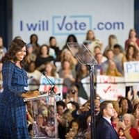 First Lady Michelle Obama speaks before a throng of suppporters at the University of Pittsburgh