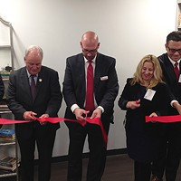 Pittsburgh Mayor Bill Peduto (left), U.S. Congressman Mike Doyle (center left), and PATF CEO Sean DeYoung (center) cut the ribbon on new PATF facility.