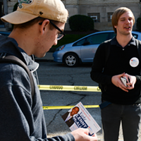 College Republican Arnaud Armstrong hands out flyers for Congressional candidate Lenny McAllister