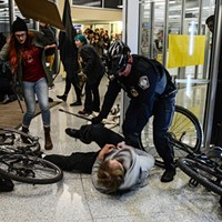 Protesters clash with police on the University of Pittsburgh campus.