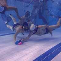 Underwater-hockey players jockey for the puck.
