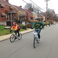 Jeremiah Sullivan (right) rides up a hill during the Dirty Dozen bike race.