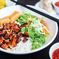 Bun vermicelli with chicken, lettuce and carrots over rice noodles
