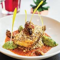 Poached sea bass over quinoa salad with house-made salsa and avocado chutney