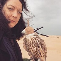 Helen Macdonald with a saker Falcon