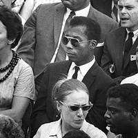 Alone in a crowd: James Baldwin (center)