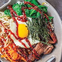 <i>Bi bim bap</i> with wagyu beef, carrots, bean sprouts, spinach, dippy egg, Korean BBQ sauce and rice