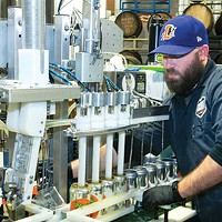 Jon Ebner, of Iron Heart Canning Co., cans Bigger Hop.