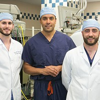UPMC neurosurgeon David Okonkwo, center, with his current residents Gregory Weiner (left) and David Salvetti