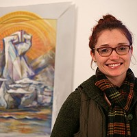 Randi Stewart with her mixed-media painting, part of AIR's Active Voice show