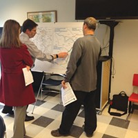 Officials presenting Mon-Fayette Expressway plans to residents, at the Monroeville Public Library
