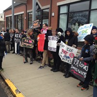 Immigrant-rights advocates and constituents protest outside Dom Costa's office in Morningside.