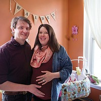 Braiden Alan and Maya Guerin next to their nursery at 3447 Melwood Ave., in Polish Hill