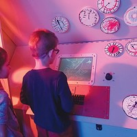 Kids try out Ice Station Zebra, at the Children's Museum