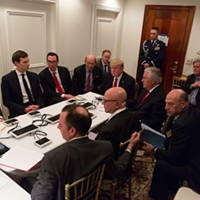 President Donald Trump receives a briefing on a military strike on Syria from his National Security team on April 6.