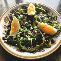 Grilled asparagus with ramps, hard-boiled egg and horseradish